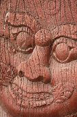 stock photo of wood craft  - Ancient giant face craft with wood texture