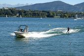 image of ski boat  - Water skiing on a mountain lake - JPG