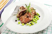 foto of snow peas  - fried chicken livers with snow peas and rosemary on a white plate - JPG