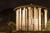 stock photo of hercules  - Roman Hercules temple at night Rome Italy - JPG