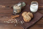 stock photo of baked raisin cookies  - rustic oatmeal cookies with milk close - JPG