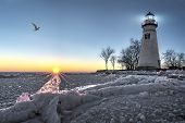 pic of marblehead  - The historic Marblehead Lighthouse in Northwest Ohio sits along the rocky shores of the frozen Lake Erie - JPG