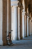 stock photo of vicenza  - Perspective of the columns at the bottom of the Basilica palladiana in Vicenza - JPG