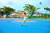 picture of playground  - young boy throwing ball playing basketball on playground - JPG
