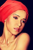 stock photo of turban  - Attractive woman with make up and head in turban - JPG