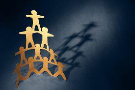 image of human pyramid  - Human team pyramid holding hands - JPG