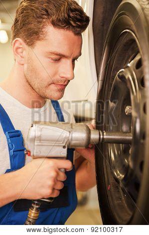 Man Removing Tires.
