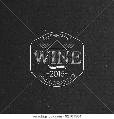 ornate wine label on cardboard texture