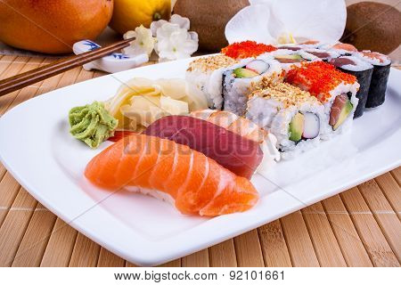 Appetizing Sushi With Wasabi, Fruits And Chopsticks