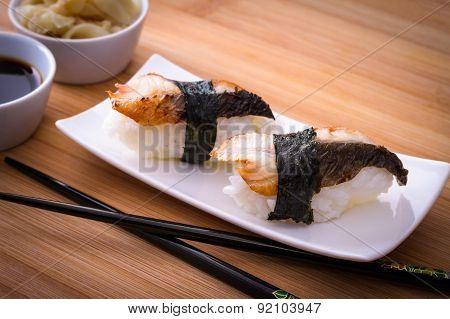 Two Nigiri Eel Sushi On Bamboo Table