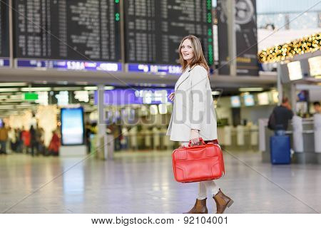 Young Woman At International Airport, Checking Electronic Board