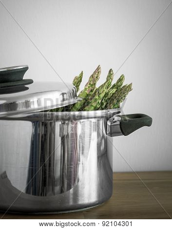 Green Asparagus In Metal Pot With Lid, Selective Focus