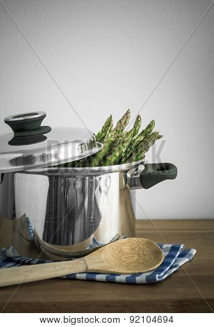 Green Asparagus In Metal Pot With Skimmer, Selective Focus