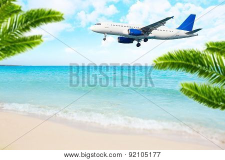 Jet airplane landing over the sea beach.