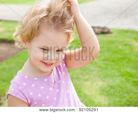 Outdoor Summer Portrait Of Cute Playful Girl