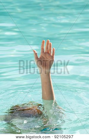 Hand Of Drowning Person Stretching Out Of Water