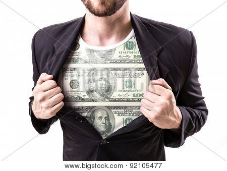 Businessman stretching suit to reveal shirt with One Hundred Dollar