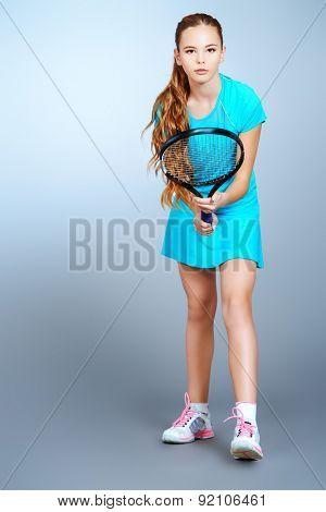 Full length portrait of a girl tennis player. Studio shot.