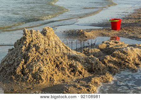 Ruined Sand Castle And Children's Bucket