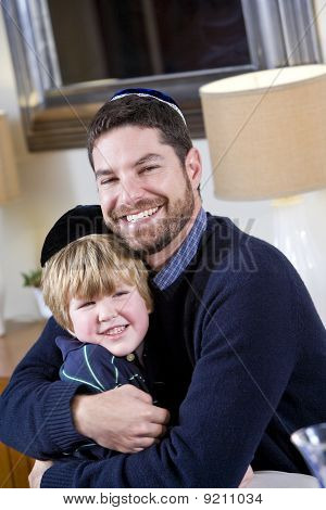 Jewish Father And Young Son Wearing Yarmulkes