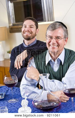 Senior Jewish Man, Adult Son Celebrating Hanukkah