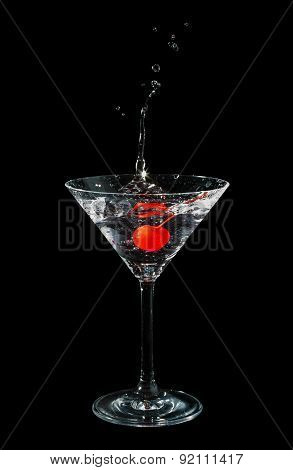 Maraschino cherry dropped in cocktail glass