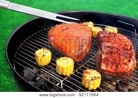 Fork, Bbq Pork Knuckle And  Spareribs On The Flaming Grill