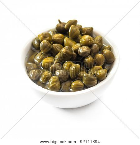 bowl of capers isolated on a white background