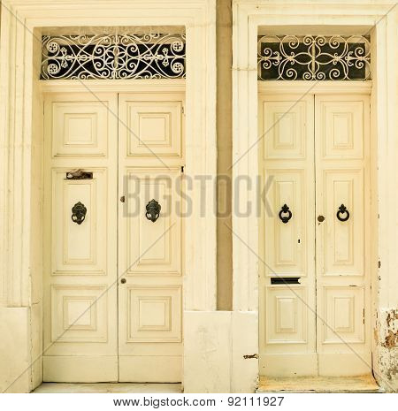 Two traditional exterior doors in Malta. The historic center of Valletta