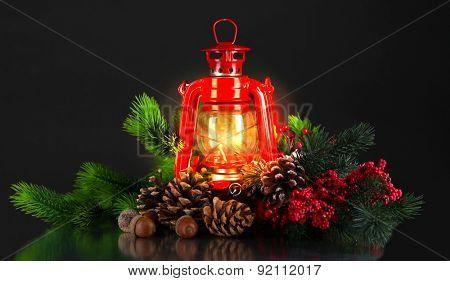 Red kerosene lamp on black background