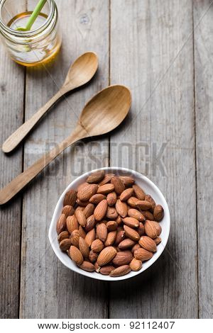 Close-up Almond Nuts On Wood Background