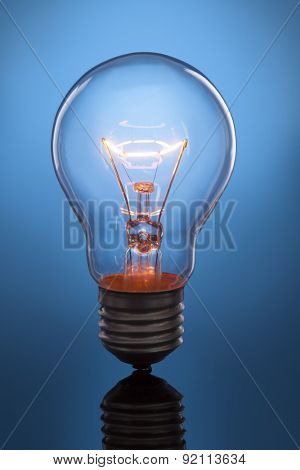 glowing lamp on blue background