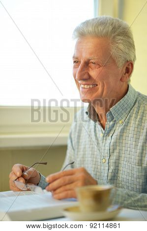 Senior man with book