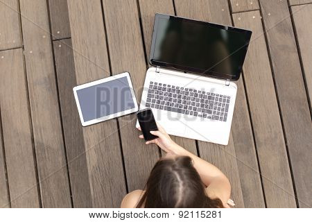 Woman Using Multiple Devices Phone Laptop And Tablet