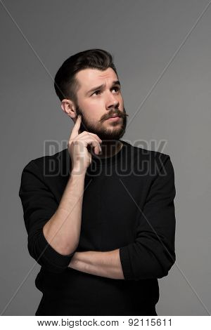 Fashion portrait of young man in black