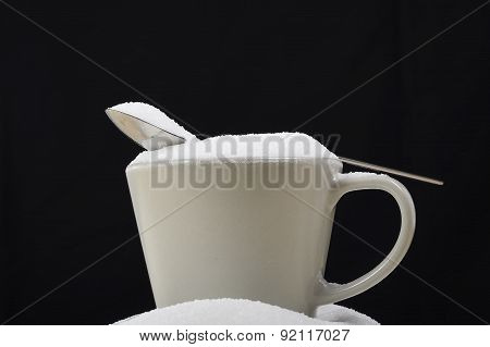Spoon Full Of Sugar Resting On Messy Coffee Cup  In Insane Sugar Addiction And Unhealthy Nutrition