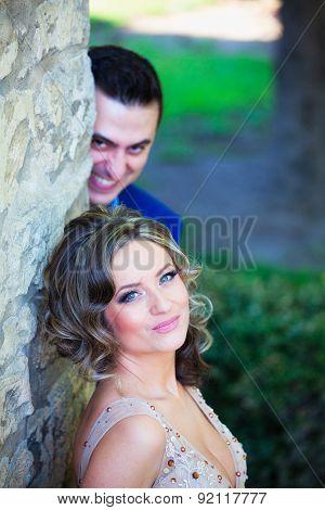 Groom Making Faces Behind Bride