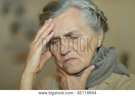 Sad aged woman