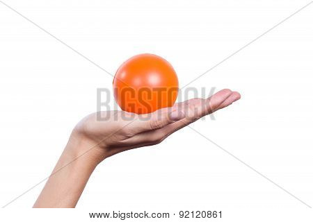 Female Hand Holding An Orange Stress Ball