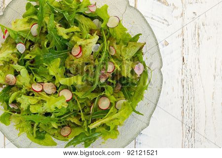Lettuce Rocket Leaves With Chopped Radishes Salad In Glass Bowl