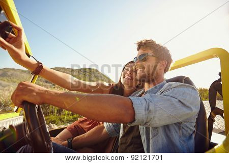 Woman Taking Selfie On Road Trip With Man