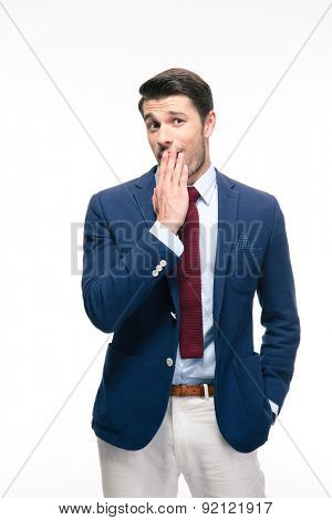 Businessman covering his mouth isolated on a white background