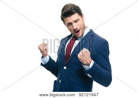 Handsome businessman celebrating his success isolated on a white background. Looking at camera