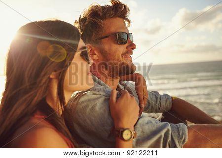 Couple Enjoying The Beach View.