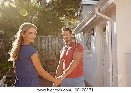 Beautiful Young Couple Outside Their House