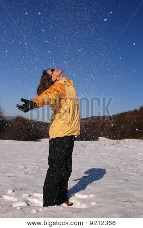 Young Pretty Woman Having Fun With Snow
