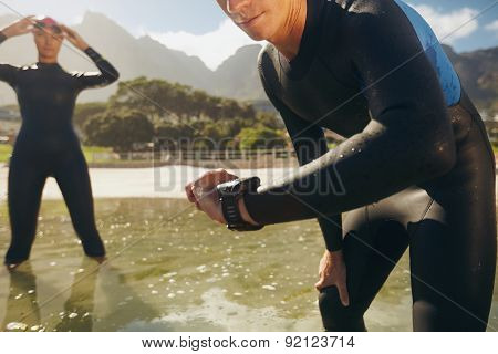 Athletes In Wet Suits Preparing For Triathlon Competition