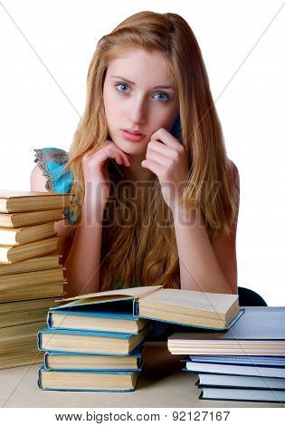The Girl With Pile Of Books And Writing-books On A White Background