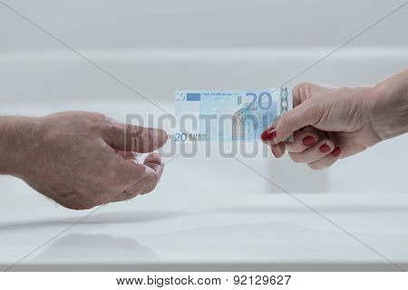 Handing An Euro Banknote