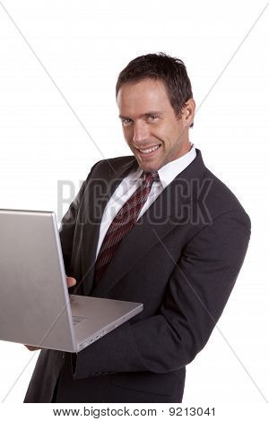 Man With Laptop And Smiling